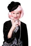 Diva on a Mike. Coy preteen diva in pink hair singing (talking) into a microphone. Front view royalty free stock images