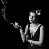 Diva que fuma Foto de archivo libre de regalías