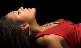 Diva in red. Woman lying on her back in elegant red dress Stock Photos
