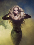 Diva in smoke. Fashion art photo diva coming out of the smoke royalty free stock images