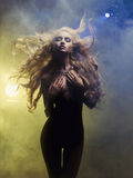 Diva in smoke. Fashion art photo of diva coming out of the smoke royalty free stock photos