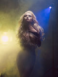 Diva in smoke. Fashion art photo of diva coming out of the smoke royalty free stock photo