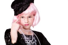 Diva Wearing Specs. Preteen diva with pink hair and retro eyeglasses royalty free stock photos