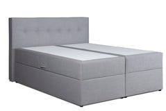 Divan bed. A large grey divan bed stock image