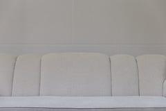 divan beige de sofa de tissu Photos libres de droits
