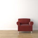 Divan rouge sur le mur blanc Photographie stock libre de droits