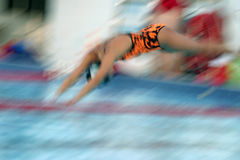 Dive on in.. Motion blur of competition swimmer stock photography