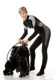 Before dive. Woman checking her dive gear Royalty Free Stock Photography