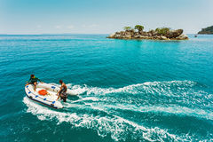 Dive boat heading to the island in a tropical sea Stock Image