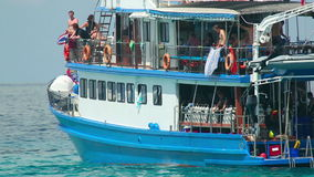 Dive boat. PHAN NGA, THAILAND - NOVEMBER 23, 2014: Dive boat returns to the island, near Ko Miang island, number 4 of Similan Islands, on November 23, 2014 stock footage