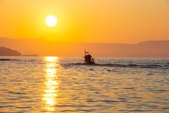 A dive boat in the sunset royalty free stock images