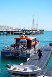 Dive Boat and Swanage Pier. Royalty Free Stock Images