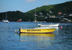 Dive boats at anchor in the grenadines Stock Photo