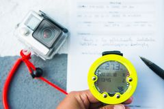 Dive computer watch for diving and action camera Stock Image