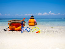 Dive equipment on sea shore. In vacation trip, tropical summer ocean stock photos