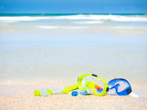 Dive equipment on white sand beach Royalty Free Stock Photography