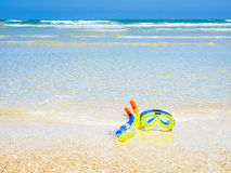 Dive equipment on white sand beach Royalty Free Stock Image