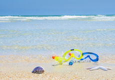 Dive equipment on white sand beach Stock Images