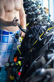 Guy checking the diving equipmenet. Stock Images