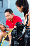 Dive master and student in Asian diving school Stock Images