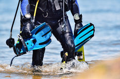 After the dive. Scuba diver after the dive is beached stock photography