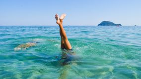 Dive into the sea. Dive into the sea with your feet up. Beach fun stock images