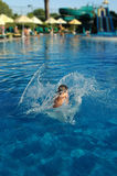 Dive with a splash 3. Woman jumping in a pool. Conceptual shot for summer related scenario Royalty Free Stock Image