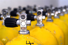 Dive tank. Row of dive tanks with large depth of field Royalty Free Stock Photo