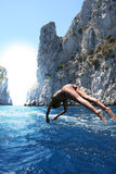 A dive towards the summer / Plunge. A dive towards the summer / A girl in costume plunges into the ocean / Capri island (Italy Royalty Free Stock Images