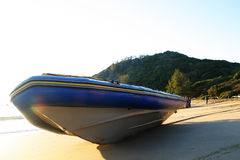 Diveboat on the beach. Dive boat lying in the early morning sun stock photography