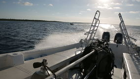 Diveboat rushes near the mangroves forest. Jardines de la reina, Cuba stock video