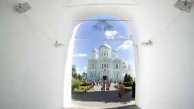 DIVEEVO, RUSSIA Unknown pilgrims go to morning Divine Liturgy at Trinity Cathedral Royalty Free Stock Photo