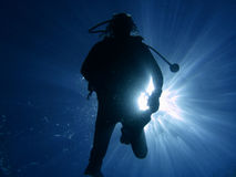Diver 06. Diver in back light and sun rays stock image