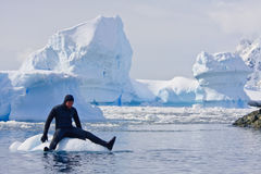 Diver on the. Ice against the blue iceberg. Antarctica Royalty Free Stock Images