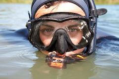 Diver. Portrait of diver in diving suit and mask looking out of the water. Close-up Stock Photo