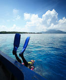 Diver. Doing back flip into blue transparent sea from a boat's board Royalty Free Stock Photo