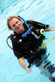Diver. Happy scuba diver in the swimming pool Royalty Free Stock Image