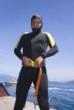 Diver. Put on his weight belt Stock Images