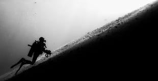 Diver Ascending. A diagonal slope Stock Photography
