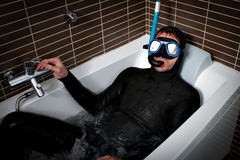 Diver in bath immersion. Bizarre shot Stock Images