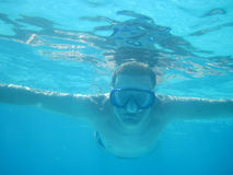 Diver in blue water Royalty Free Stock Images