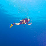 Diver with bright yellow fins Royalty Free Stock Photo