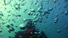 Diver and bubbles stock footage
