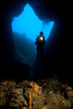 Diver & Cave. A scuba diver is exploring a underwater cave stock image