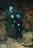 Diver in cave Stock Images