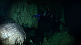 Diver in caves of Yucatan cenotes underwater in Mexico. Scuba diving. Rocks and stones in clean water stock footage