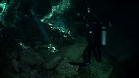 Diver in caves of Yucatan cenotes underwater in Mexico. Scuba diving. Rocks and stones in clean water stock video