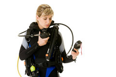 Diver checking pressure Royalty Free Stock Photography