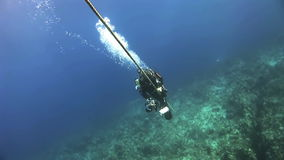 A diver climbs the rope stock footage
