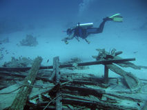 Diver in deep. And wreck of ship royalty free stock photography